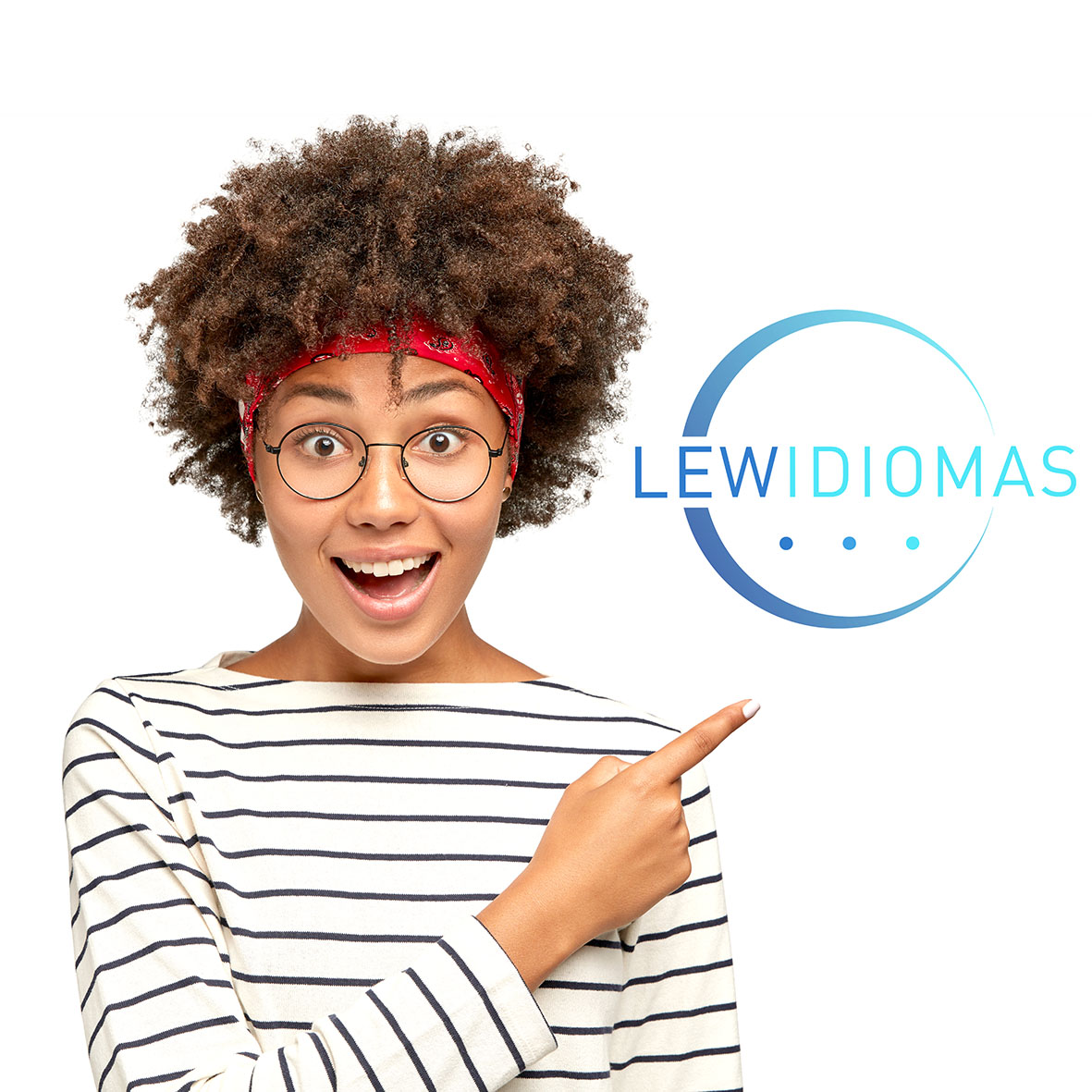 Studio shot of positive dark skinned girl wears round transparent glasses, striped white sweater, indicates with index finger at upper right corner, shows free space for advert. Promotion concept